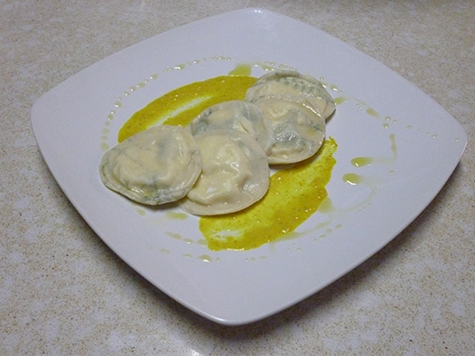 Goat Cheese and Dill Ravioli with Curry Cream Sauce
